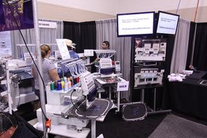 TheEmbroideryWarehouse showing the Butterfly Embroidery Machine at the ISS Show in Fort Worth, Texas 2013